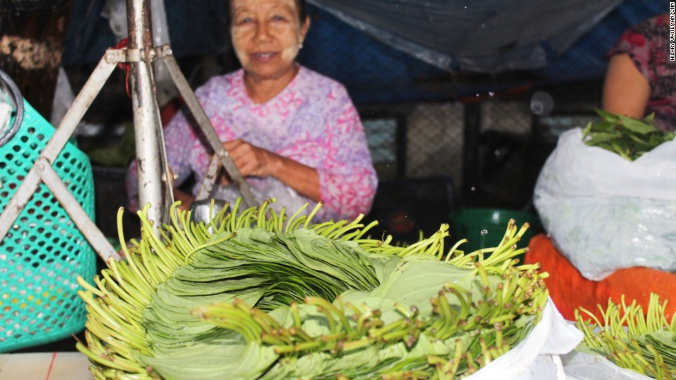 A woman sells betel leaves at a market in central Yangon. The climbing plant is grown throughout Asia, but predominantly in India and Bangladesh, according to Kew.org.