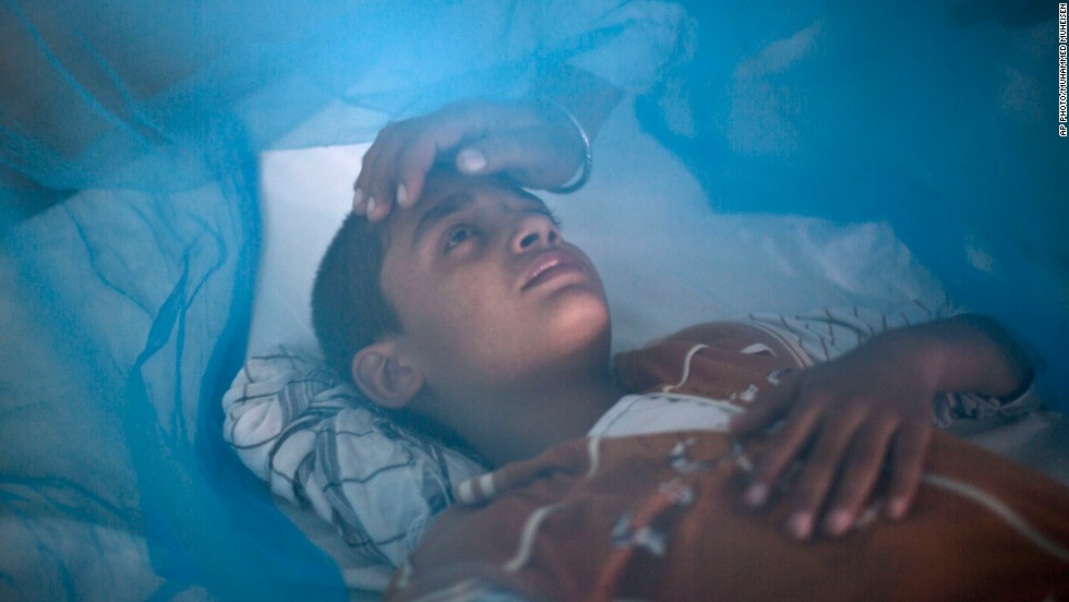 "OCTOBER 25 - RAWALPINDI, PAKISTAN: 13-year-old Awais Shaukat lies in bed, <a href=""http://www.cnn.com/2010/HEALTH/07/22/dengue.fever/"">sick with dengue fever</a>. Dengue, a flu-like illness, is spread by the Aedes mosquito and unlike malaria, there are no drugs to prevent it. It spikes during the annual monsoons, when the insects breed in puddles of stagnant water. So far, <a href=""http://www.cnn.com/HEALTH/library/dengue-fever/DS01028.html"">attempts to develop a vaccine have been unsuccessful</a>."