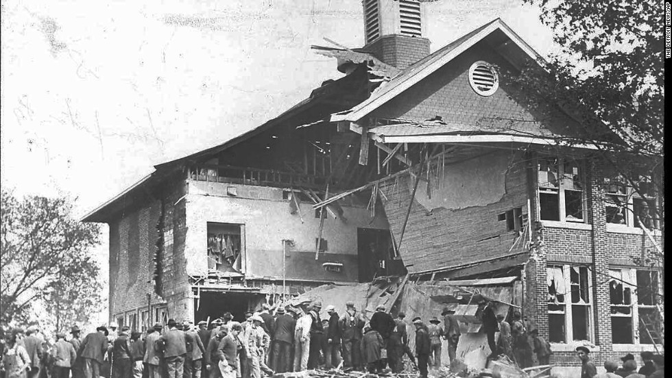 In May 1927, Bath, Michigan, school board member Andrew Kehoe exploded dynamite in the community's school, killing dozens of children and several adults. Here, residents searched for survivors.
