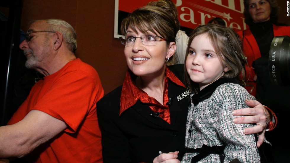 Palin holds her daughter Piper as she watches results on election night in November 2006. The former mayor of Wasilla became Alaska's first female governor.