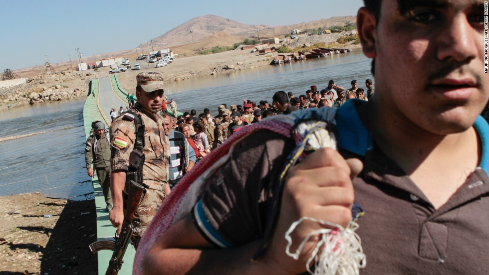 Syrian refugees are turned back after being refused entry into northern Iraq on Wednesday, October 23.