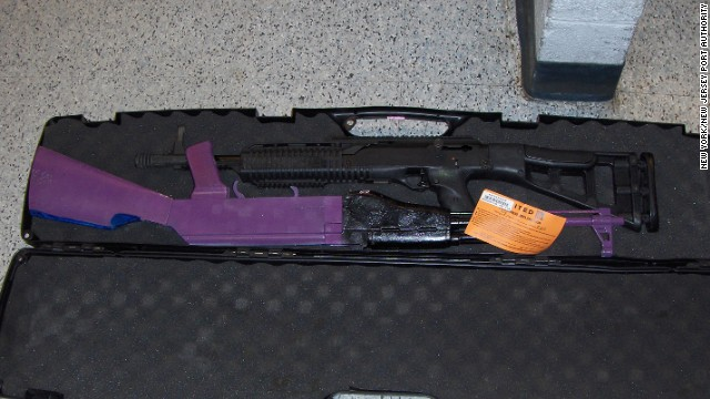 The rifle painted purple was considered to be illegally defaced. The black shotgun is legal to possess.