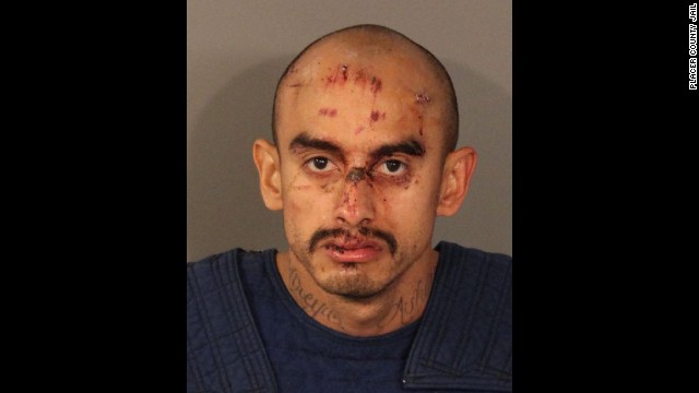 Samuel Duran surrendered after being holed up in a house for hours following a gunfight that left three officers injured.