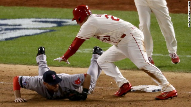 ST LOUIS, MO - OCTOBER 26:  Allen Craig #21 of the St. Louis Cardinals gets tripped up by Will Middlebrooks #16 of the Boston Red Sox during the ninth inning of Game Three of the 2013 World Series at Busch Stadium on October 26, 2013 in St Louis, Missouri.  (Photo by Rob Carr/Getty Images)