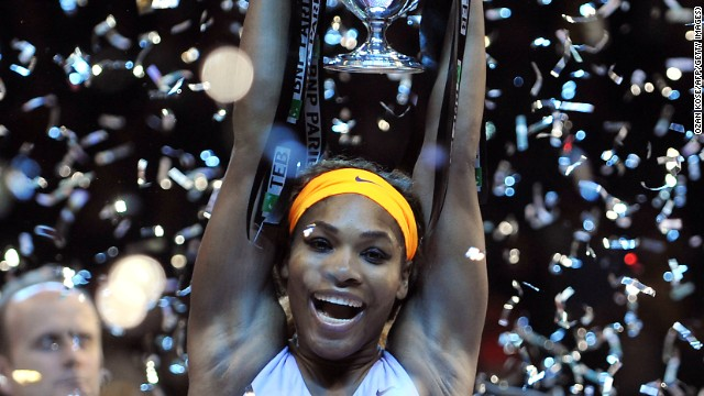 A relieved Serena Williams lifts the WTA Championship title aloft after beating Li Na in a three set final.