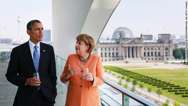 BERLIN, GERMANY - JUNE 19: In this handout photo provided by the German Government Press Office (BPA), U.S. President Barack Obama (L) and German Chancellor Angela Merkel chat prior to a lunch at the terrace of the Chancellery on June 19, 2013 in Berlin, Germany. Obama is visiting Berlin for the first time during his presidency and his speech at the Brandenburg Gate is to be the highlight. Obama will be speaking close to the 50th anniversary of the historic speech by then U.S. President John F. Kennedy in Berlin in 1963, during which he proclaimed the famous sentence: Ich bin ein Berliner.