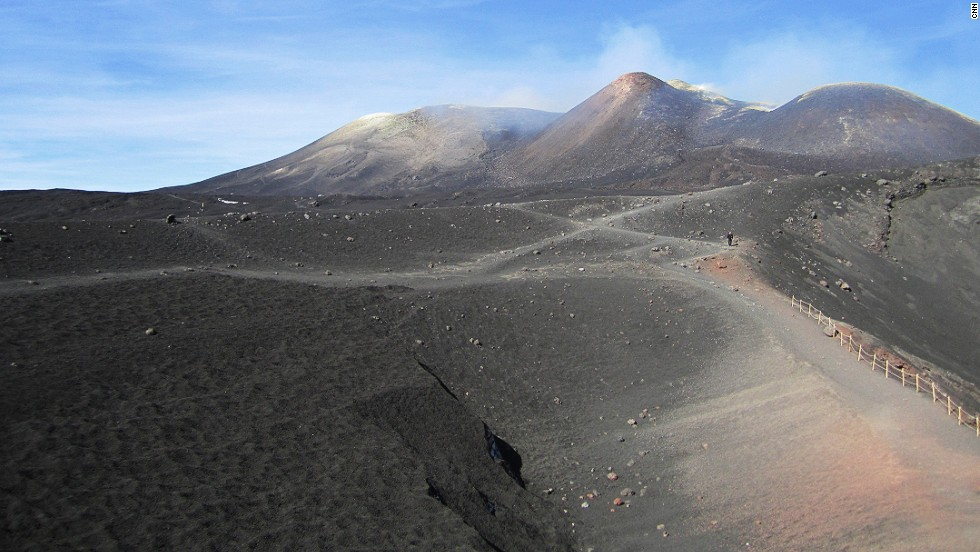 A view from 2,800 meters up the mountain, looking toward the peak of Mount Etna. The top of the volcano is actually a series of craters. Because it erupts frequently, Etna's landscape is constantly changing. These images were taken just a few days before the most recent eruption on October 26, 2013.