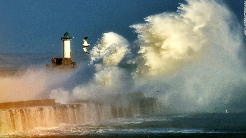 "OCTOBER 28 - BOULOGNE, FRANCE: Large waves break against the harbor wall at the entrance of the port of Boulogne, northern France, on October 28, 2013. A fierce storm battered Europe and the<a href=""http://cnn.com/2013/10/28/world/europe/uk-severe-weather/index.html?hpt=hp_t3""> south of England, leaving at least two people dead.</a> Weather forecasters had said before the storm arrived that it could be the region's worst in a decade."