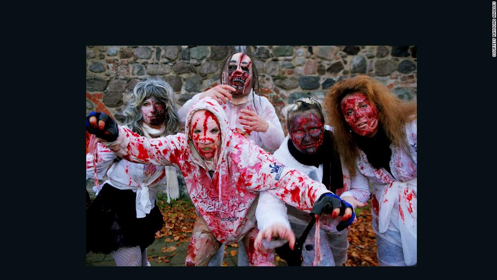 """On October 26 the annual Zombie Walk took place in Berlin. Raymond Angeles went there <a href=""""http://ireport.cnn.com/docs/DOC-1053693"""" target=""""_blank"""">armed with his camera</a> to capture the beasts walking through the German capital. """"The atmosphere during the walk was super.  A lot of spectators in the streets, cafes, restaurants and shops watched, giggled and took pictures with their cell phones, some even joined in the parade.  School classes walking in the streets were screaming and laughing as they were chased by the zombies,"""" he said."""