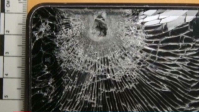 Cell phone blocks bullet, saves clerk