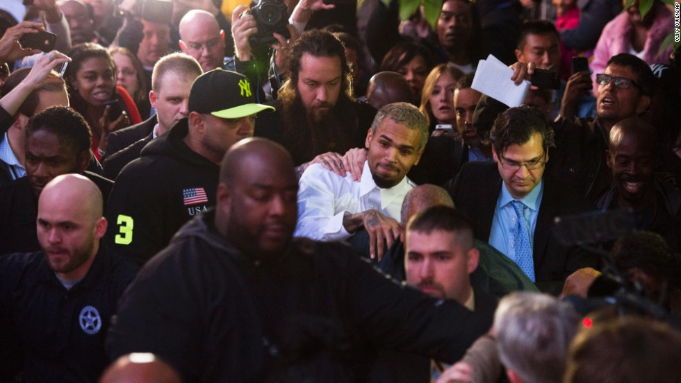 "<strong>October 2013:</strong> <a href=""http://www.cnn.com/2013/10/28/showbiz/chris-brown-assault-charge/index.html"">Brown and a bodyguard were accused of assaulting a man</a> on a Washington sidewalk on October 27. The man told police he tried to jump into a photo that Brown was posing for with a female fan when the singer said, ""I'm not down with that gay s--t"" and ""I feel like boxing.""  Isaac Adams Parker said Brown punched him in the face, the police report said. Brown was released from jail the next day."