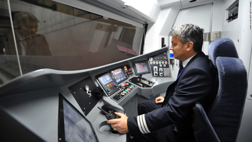 A driver inspects a train before the opening. The Marmaray project, part of the Turkish government's plan to expand the country's economy, cost $4.5 billion.