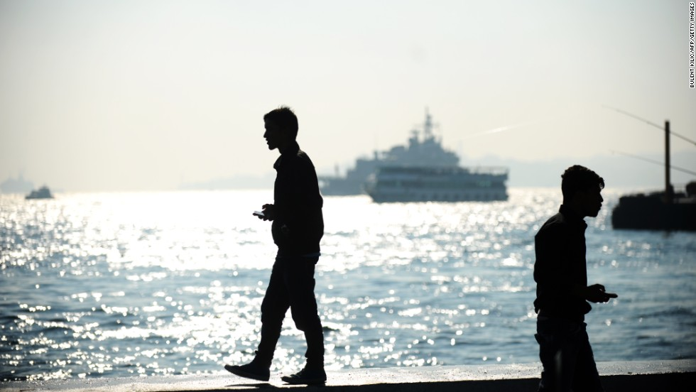 A man stands near the Bosphorus on Monday in Istanbul.