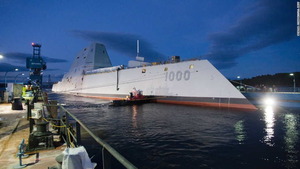 "The USS Zumwalt, the U.S. Navy's newest warship, floats out of dry dock Monday, October 28, in Bath, Maine. The first of the new <a href=""http://security.blogs.cnn.com/2013/10/29/bigger-faster-deadlier-navy-launches-new-stealth-destroyer/"">DDG-1000 class of destroyers</a>, it will be the Navy's largest stealthy ship when it begins missions."