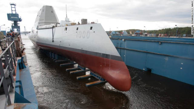 "BATH, Maine (Oct. 28, 2013) The Zumwalt-class guided-missile destroyer DDG 1000 is floated out of dry dock at the General Dynamics Bath Iron Works shipyard. The ship, the first of three Zumwalt-class destroyers, will provide independent forward presence and deterrence, support special operations forces and operate as part of joint and combined expeditionary forces. The lead ship and class are named in honor of former Chief of Naval Operations Adm. Elmo R. ""Bud"" Zumwalt Jr., who served as chief of naval operations from 1970-1974. (U.S. Navy photo courtesy of General Dynamics/Released)"