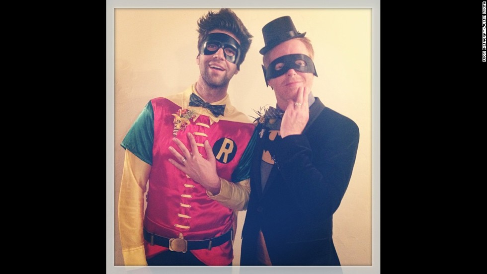 "Hyland's ""Modern Family"" co-star Jesse Tyler Ferguson is still enjoying newlywed bliss. He and Justin Mikita, left, dressed up as Batman and Robin. ""Finally, batman & robin got married!"" <a href=""http://instagram.com/p/f9I9p8glgH/"" target=""_blank"">Mikita said in the photo's caption on Instagram. </a>"