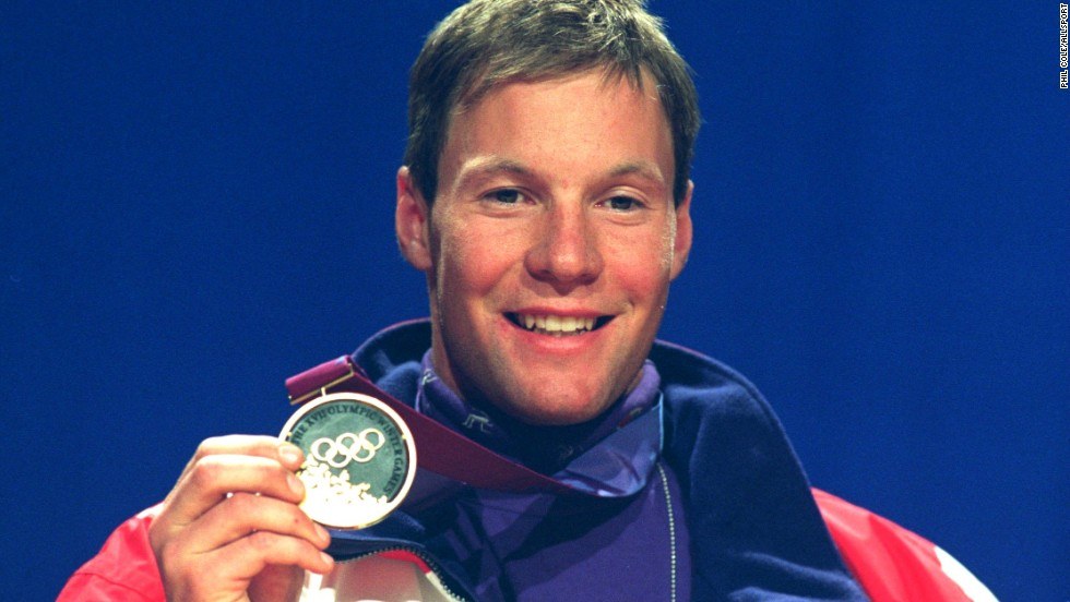 "Men's downhill skiing winner Tommy Moe from the U.S. proudly shows off his gold. All the medals at the 1994 Winter Olympics incorporated stone extracted from the ski jump arena during construction. Lillehammer was known as the first ""green"" Games, enshrining now-familiar values of conservation and sustainability."