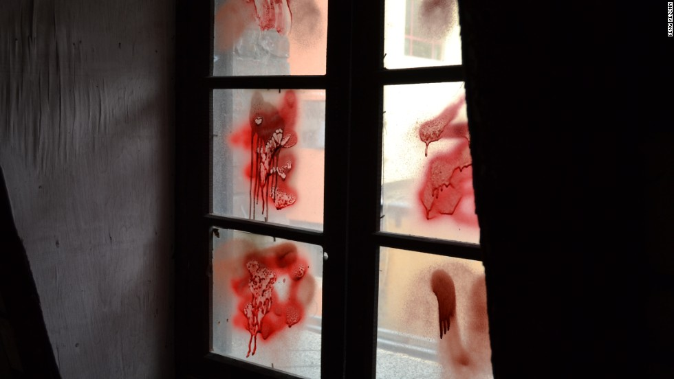 Seems someone felt the building wasn't spooky enough. Red spray paint adds unconvincing blood stains to the window.