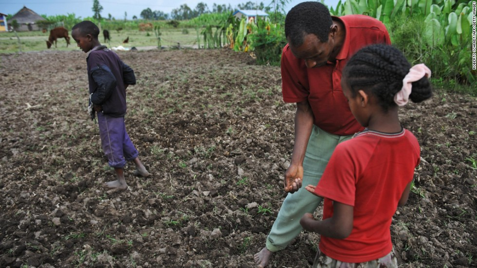"A farmer and his children plant a field with bean seeds and fertilizer in southern Ethiopia in 2008, a year after severe floods destroyed most of the food crop. Ethiopia is the country 10th most vulnerable to climate change effects, <a href=""http://www.cnn.com/2013/10/29/world/climate-change-vulnerability-index/index.html"">according to a 2013 report by Maplecroft</a>."