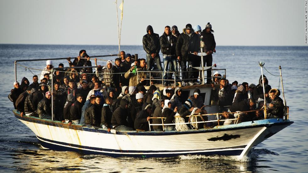 A boatfull of immigrants approaches the island in March 2011.