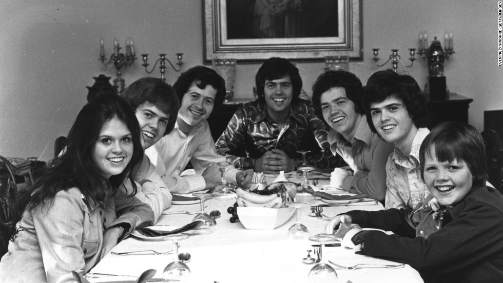 "As Sly and the Family Stone sang, the '70s really were a family affair. Following the monstrous popularity of The Jackson 5, another musical family climbed to pop stardom: The Osmonds. In the early '70s, the group -- consisting of brothers, from left, Merrill, Wayne, Alan, Jay and Donny, seen here with brother Jimmy, right, and sister Marie, left --  transitioned from their barbershop harmonies and variety shows to teen idol status with songs like ""One Bad Apple."" Eventually, Marie and Jimmy got in on the act, too."