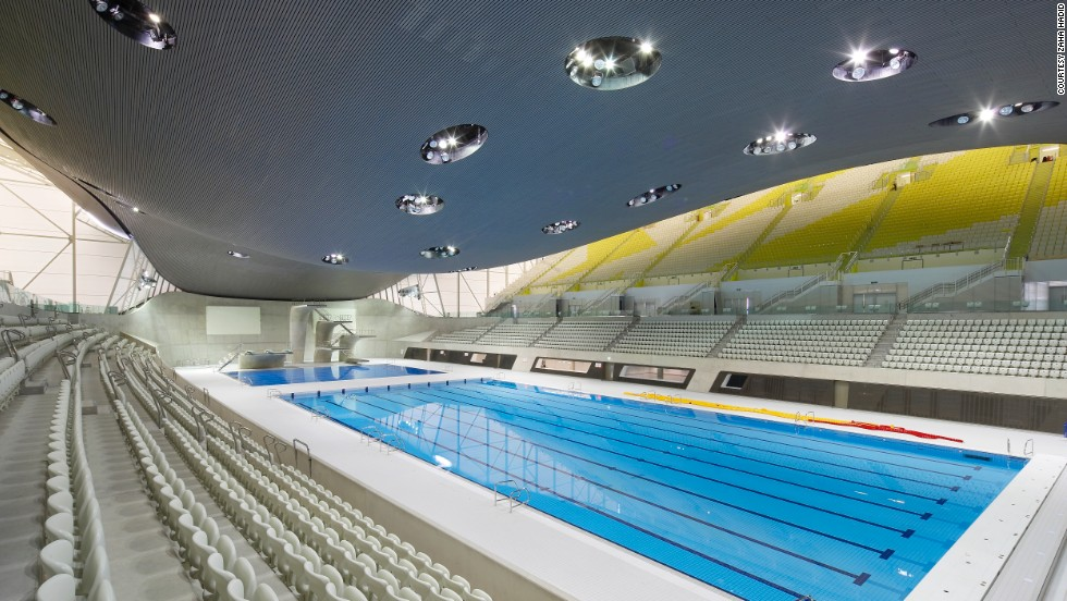"Hadid's Aquatic Centre, built for the London 2012 Olympic Games, featured a distinctive sweeping ceiling. ""An undulating roof sweeps up from the ground as a wave, enclosing the pools of the Centre with its unifying gesture,"" she says on her website."