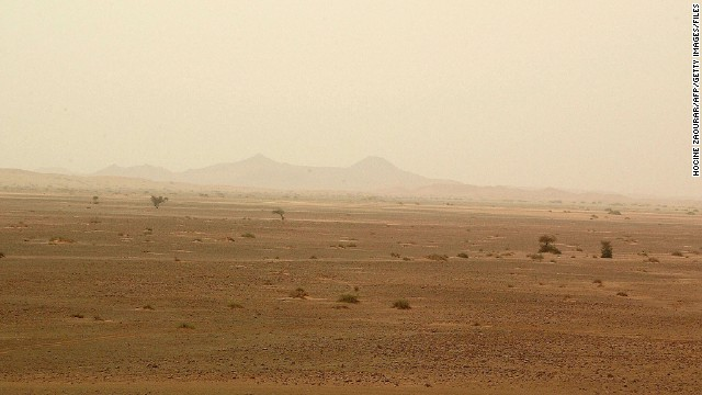 A landscape view dated May 2003 shows the Saharan desert in southern Algeria near the city of Illizi. 31 European tourists are missing in Algeria since mid-February. The tourists, 15 Germans, 10 Austrians, 4 Swiss nationals, a Dutchman and a Swede, are feared to have been kidnapped by an armed group or by smugglers. They were travelling in six separate groups in four-wheel vehicles and motorbikes without guides when they disappeared over the period of one month in the vast Sahara, which covers two million square kilometers (775,000 square miles) in Algeria alone. According to the Swiss Hebdo magazine on Sunday 11 May 2003, the tourists are all alive and ransom has been demanded for their return. AFP PHOTO HOCINE ZAOURAR (Photo credit should read HOCINE ZAOURAR/AFP/Getty Images)