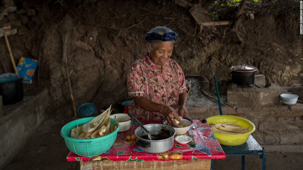 """An elderly woman hand makes traditional tamales for the Day of the Dead festival. """"This is one of my favorite aspects of Dia de los Muertos because my father, who recently passed away, wasn't too keen on skulls. Making tamales, bread and other favorite foods that their loved ones would have enjoyed is an important aspect of this celebration,"""" says Cano-Murillo, """"Eventually, we are all going to take our turn so wouldn't it be nice if your family and friends took a day out to remember you."""""""