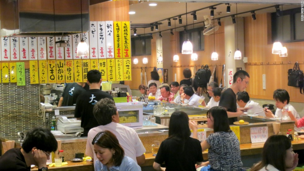 In the Taito Ward of Tokyo, excellent izakayas are well-represented, places where a hardworking salary man can have a beer or some sake or many beers and many sakes, according to Bourdain.