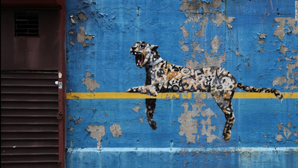 A leopard placed on the wall of New York's Yankee Stadium was revealed in October 2013.