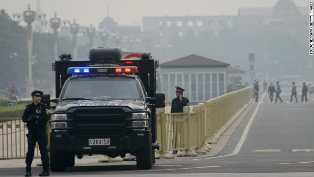 Armed police stand guard at Tiananamen Square in Beijing on Thursday.