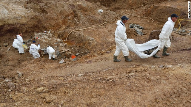 Forensic experts, members of the International Commission on Missing Persons (ICMP), and Bosnian workers search for human remains at a mass grave in the village of Tomasica, near the Bosnian town of Prijedor, 260 kms north west of Sarajevo, on Thursday, Oct. 31, 2013. Forensic experts have unearthed the 360 body  remains so far , but believe there are many more yet undiscovered as they excavate a 7 meters deep trench to find the remains of Bosniaks and Croats killed by Serb forces during their campaign to eliminate all non-Serbs from parts of the country they controlled during the 1992-95 Bosnian war. Authorities are still searching for 1,200 Bosniaks and Croats missing from the area of Prijedor. (AP Photo/Amel Emric)