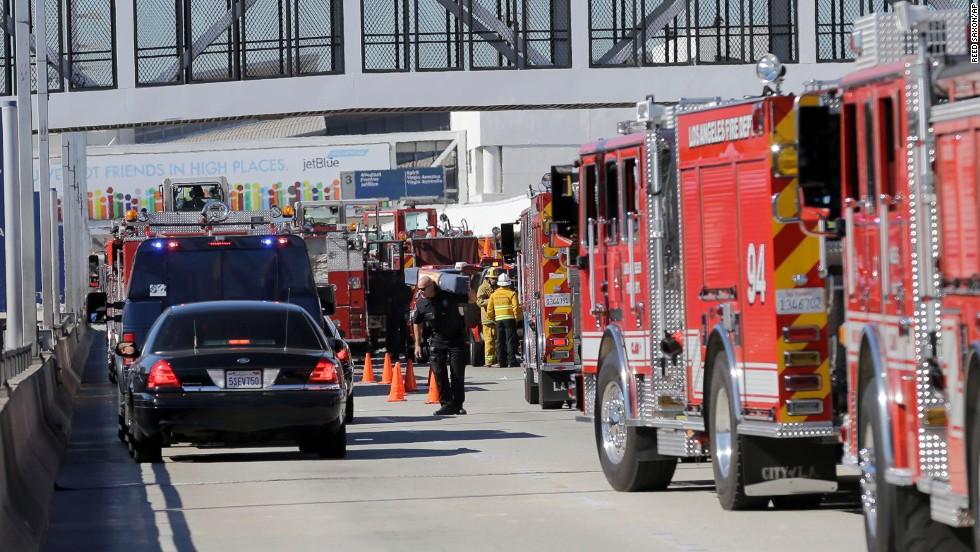 First responders and emergency vehicles arrive at the airport.