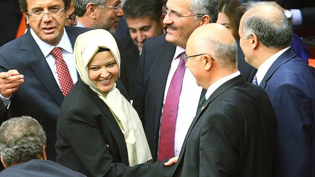 Turkey's ruling Justice and Development Party (AKP) MP Nurcan Dalbudak (C) is greeted wearing a headscarf as she attends a general assembly at the Turkish Parliament in Ankara on October 31, 2013. Four female lawmakers from Turkey's Islamic-rooted government attended a parliament session on October 31 wearing headscarves, for the first time since a ban was lifted in the staunchly secular country. AFP PHOTO/ADEM ALTANADEM ALTAN/AFP/Getty Images