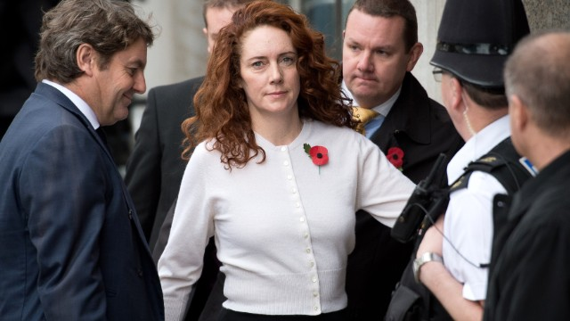 Rebekah Brooks and her husband Charlie (L) attend the phone-hacking trial at the Old Bailey on November 1.