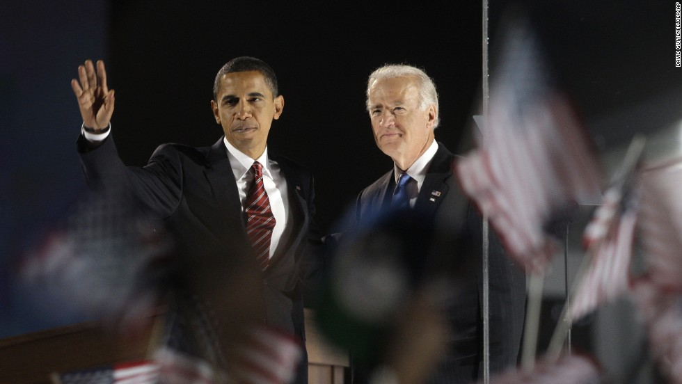 Biden and President-elect Barack Obama wave to the crowd at their election night party at Grant Park in Chicago on November 4, 2008.