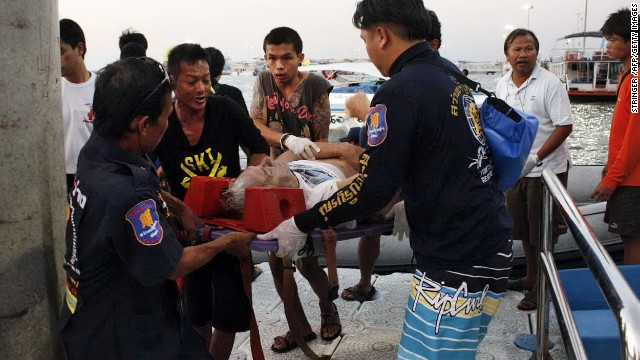 Thai rescue personnel evacuate an injured foreign tourist after a ferry sank off the coast in Pattaya on November 3, 2013.
