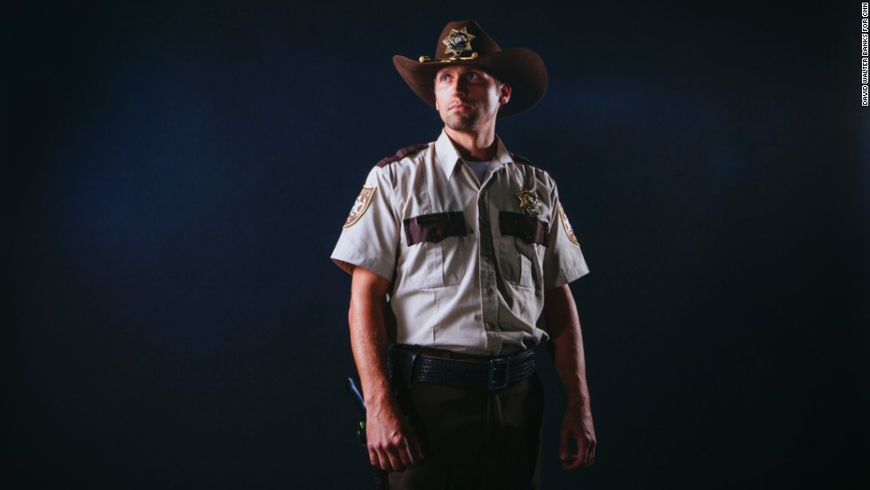 """Zombie fans gathered by the thousands at the first-ever Walker Stalker Con, which celebrated the """"The Walking Dead"""" and all things horror this past weekend in Atlanta. In this photo, Forrest Ainsworth, from Canton, Georgia, dresses as Rick Grimes from the popular television series """"The Walking Dead."""""""