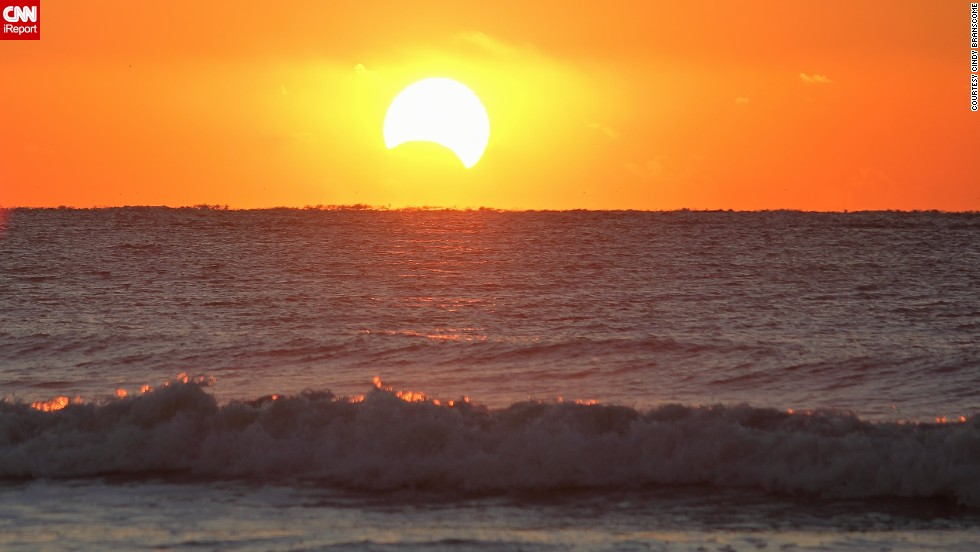 "<a href=""http://ireport.cnn.com/docs/DOC-1056278"">Cindy Branscome </a>stood at the edge of the ocean on the Isle of Palms, South Carolina, to photograph the eclipse. She said she vaguely remembers seeing an eclipse several years ago, but this time was more special because she loves photography now."