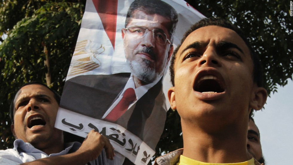 "Morsy supporters raise a poster that reads ""no to the coup"" in Arabic."