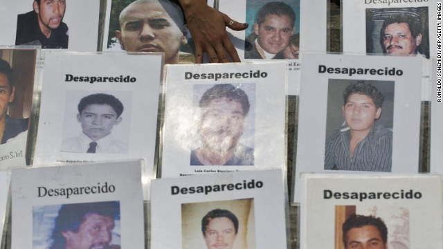 Some of the dozens of portraits of people missing in Mexico's drug war are displayed during a recent protest in Mexico City.