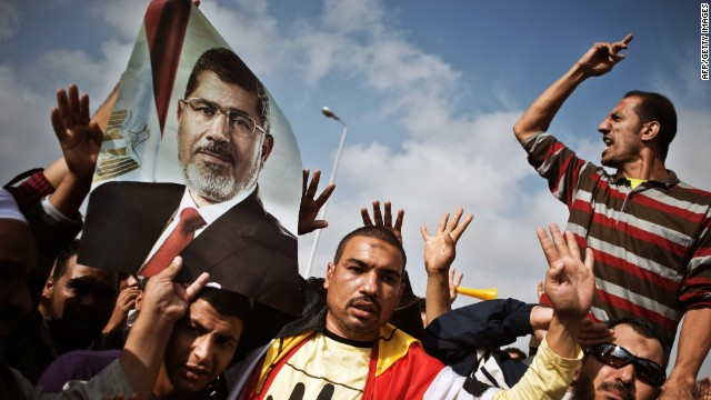 Egyptian supporters of the Muslim Brotherhood or ousted president Mohammed Morsi shout slogans in his support during a protest outside the Police Academy where Morsi's trial takes place on November 4, 2013 in Cairo, Egypt.