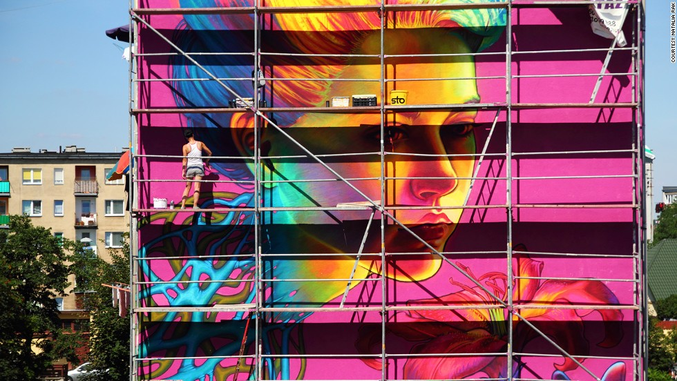 "Natalia Rak puts some finishing touches to a huge piece entitled ""Spellbound"" in Turek, Poland earlier this year."