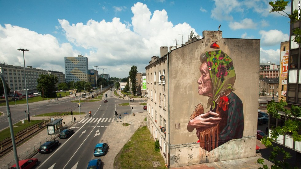 """Madam Chicken"" overlooking a city street in Lodz."