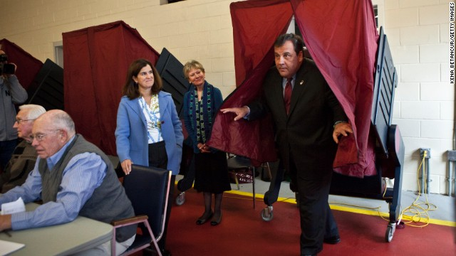 New Jersey Gov. Chris Christie exits a voting booth after casting his ballot for New Jersey governor in the general election as his wife Mary Pat Christie (L) looks on in a polling center on November 05, 2013 in Mendham, New Jersey.