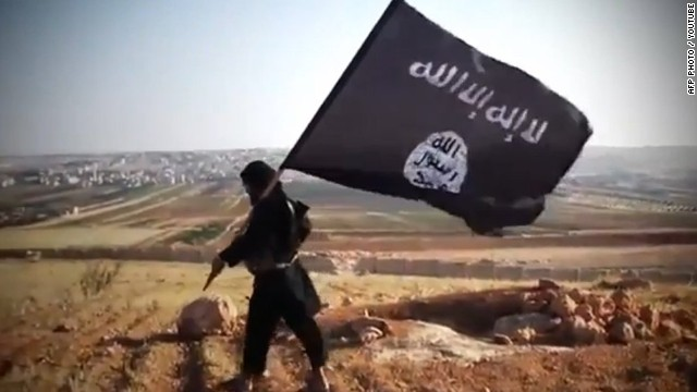 "An image grab taken from a video uploaded on YouTube on August 23, 2013 allegedly shows a member of Ussud Al-Anbar (Anbar Lions), a Jihadist group affiliated to the Islamic State of Iraq and the Levant , Al-Qaeda's front group in Iraq, holding up the trademark black and white Islamist flag at an undisclosed location in Iraq's Anbar province. Attacks in Iraq killed 14 people including six soldiers on August 25, Iraqi officials said, amid a surge in violence authorities have so far failed to stem despite wide-ranging operations targeting militants. Arabic writing on the flag reads: ""There is not God but God and Mohammed is the prophet of God."" AFP PHOTO / YOUTUBE == RESTRICTED TO EDITORIAL USE - MANDATORY CREDIT ""AFP PHOTO / YOUTUBE "" - NO MARKETING NO ADVERTISING CAMPAIGNS - DISTRIBUTED AS A SERVICE TO CLIENTS FROM FROM ALTERNATIVE SOURCES, THEREFORE AFP IS NOT RESPONSIBLE FOR ANY DIGITAL ALTERATIONS TO THE PICTURE'S EDITORIAL CONTENT, DATE AND LOCATION WHICH CANNOT BE INDEPENDENTLY VERIFIED ====-"