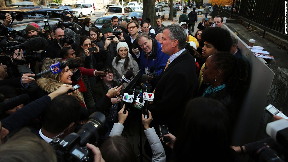 New York City mayoral candidate Bill de Blasio speaks to the media after voting at a public library branch in Brooklyn.