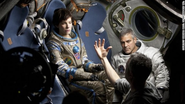 Sandra Bullock and George Clooney on the set of Gravity