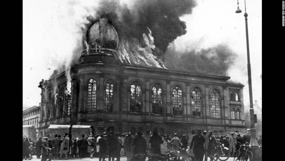 "The Boemestrasse Synagogue in Frankfurt, Germany, burns on November 10, 1938. The night of November 9 became known as ""Kristallnacht,"" or the ""Night of Broken Glass,"" after the Nazi regime staged attacks on Jewish-owned businesses, synagogues and homes throughout Germany."