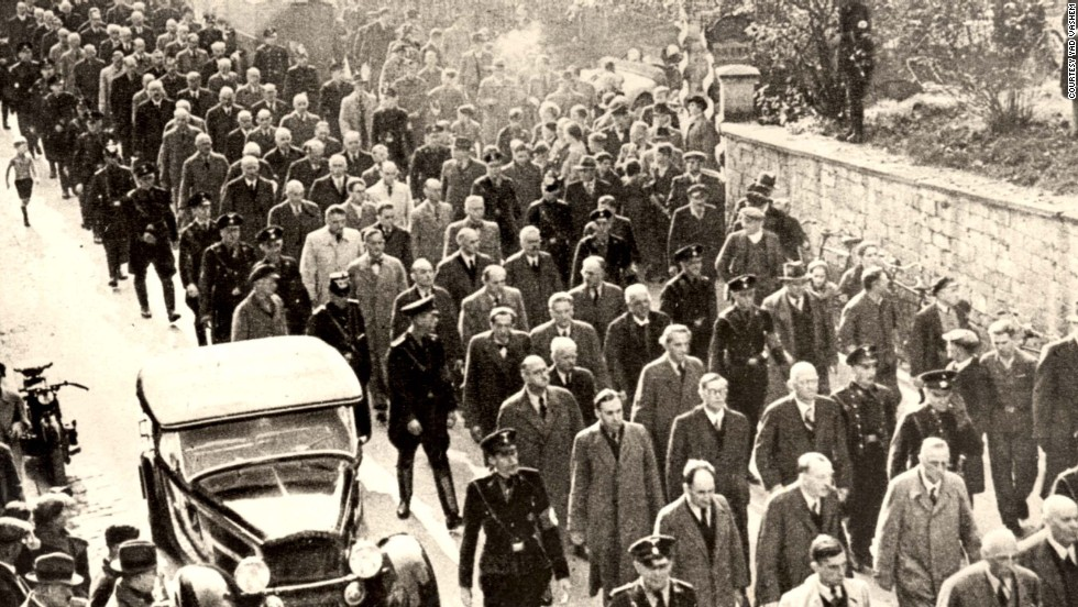 Jewish men are rounded up in Baden-Baden, Germany, for deportation to the Dachau concentration camp.